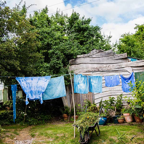 Indigo dyed fabric drying on a clothesline